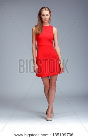 Young Gorgeous Caucasian Blonde In Red Dress Posing