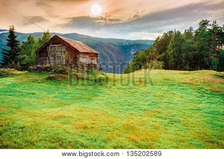 Old Abandoned House On A Background Of Norwegian Mountains.