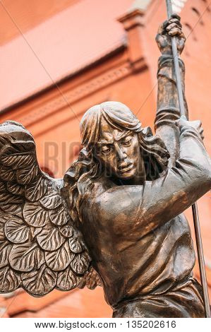 Close Up Of Statue Of Archangel Michael With Outstretched Wings, Thrusting Spear Into Dragon Before Catholic Church Of St. Simon And St. Helena On Independence Square In Minsk, Belarus