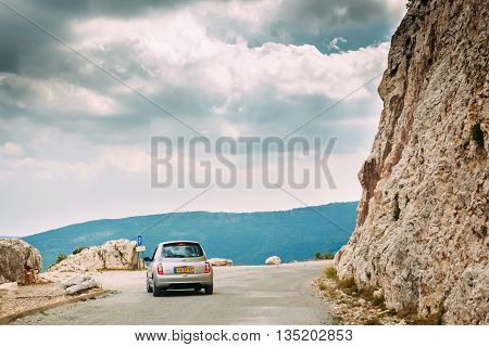 Verdon, France - June 29, 2015: Nissan Micra car on road on background of French mountain nature landscape  the Gorges Du Verdon in France
