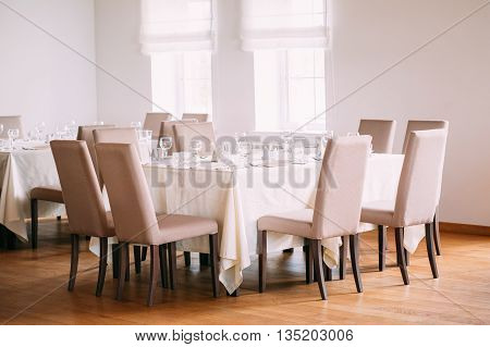 Cozy Interior Of Summer Cafe - Sheltered Tables With Tablecloths.