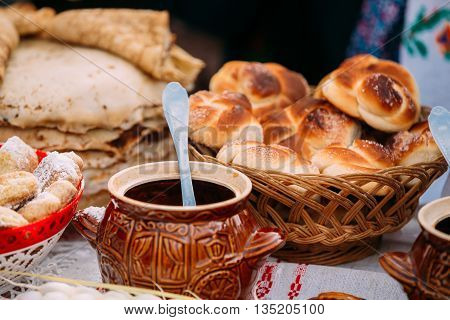 The dishes of the traditional Belarusian cuisine - fresh pastries and honey.