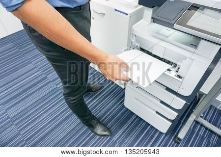 close up a business man is printing a document
