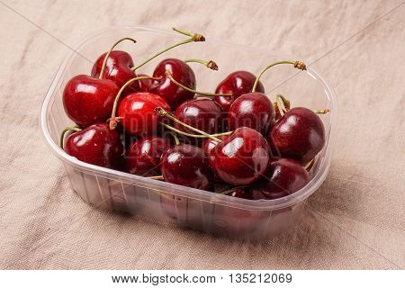 Delicious Fresh red organic Cherry cherries in a plastic box