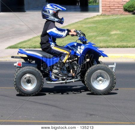 Kid On Atv