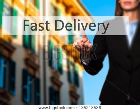 Fast Delivery - Businesswoman Hand Pressing Button On Touch Screen Interface.