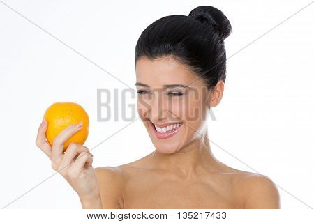 beautiful woman with a citrus in her hand