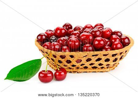 Ripe cherries in basket isolated on white background