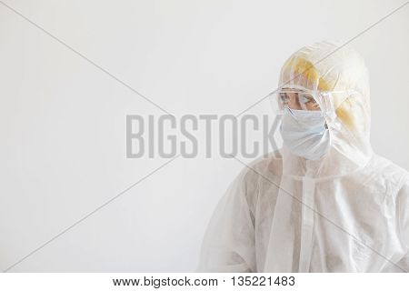 Scientist in protective wear with glasses. Woman scientist on white background