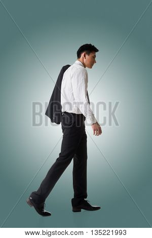Young Asian businessman hold coat and go off work, full length portrait isolated