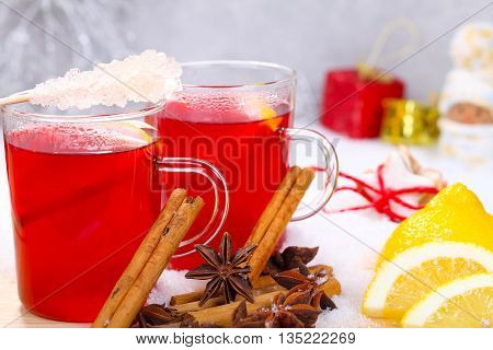 two of mulled wine with lemon, cinnamon and sugar