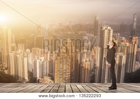 Businessman look and find something on sky.