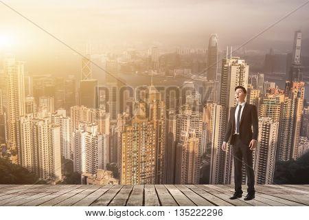 Businessman feel surprised look sky.