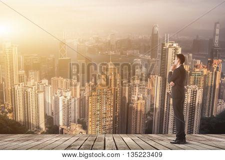 Asian businessman has a plan, copyspace on sky.
