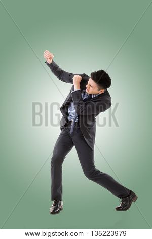 Struggle pose of Asian business man, full length isolated.