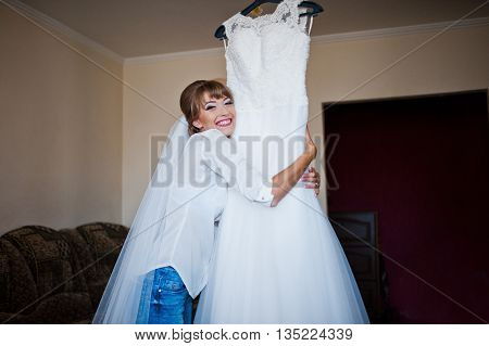Youn Happy Bride Looked At Her Wedding Dress