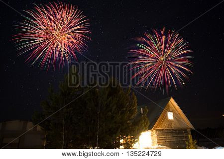 House In The Forest Over The Night Sky And Fireworks.