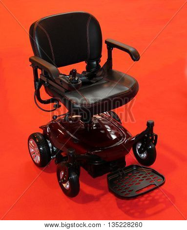 A Compact Four Wheeled Electric Disability Wheelchair.