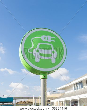 green electric car charging station symbol in Brighton UK