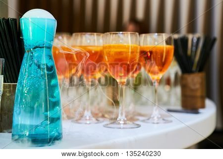 glasses of spritz aperitif aperol red cocktail with orange slices and ice cubes on wood table
