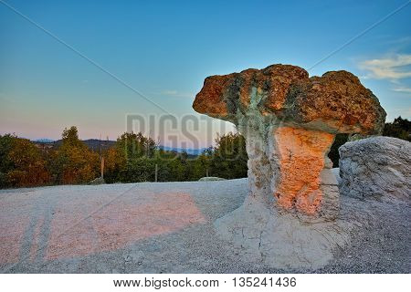 Sunrise over rock formation The Stone Mushrooms near Beli plast village, Kardzhali Region, Bulgaria