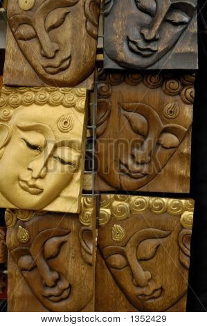A Wooden Carving Of Faces