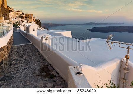 Panoramic view of Santorini island and Sunset over town of Imerovigli, Thira, Cyclades, Greece