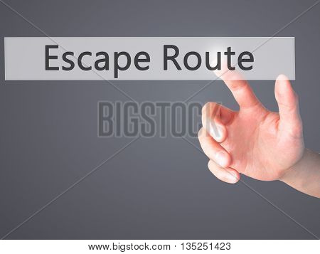Escape Route - Hand Pressing A Button On Blurred Background Concept On Visual Screen.