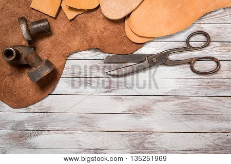 A lot of work tools and leather for shoemaker.Leather craft.
