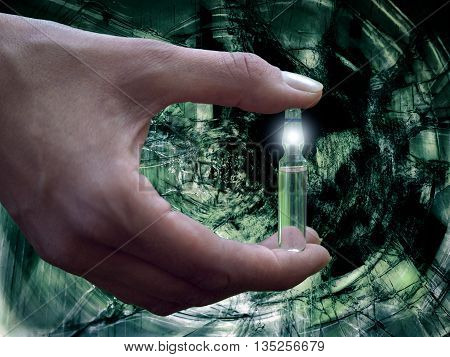 Female hand holding a vial of medicine. Background volume gloomy tunnel motion speed. The concept - a panacea a cure for the disease. Drug addict