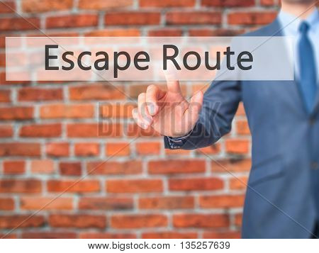 Escape Route - Businessman Hand Pressing Button On Touch Screen Interface.