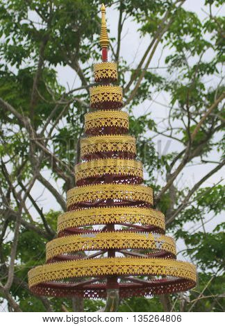 Chhatra parasol over a Buddha statue, symbolizing protection from defilement, school near Ranot, Thailand