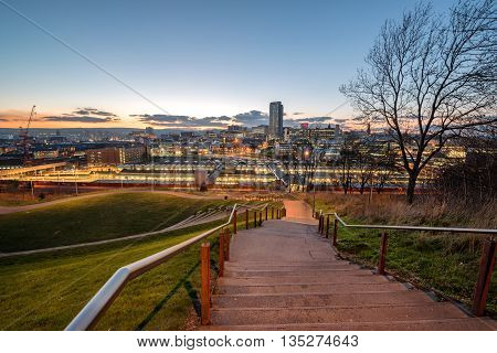 The skyline of Sheffield city centre seen from South Street Park above the city's main rail station South Yorkshire England UK