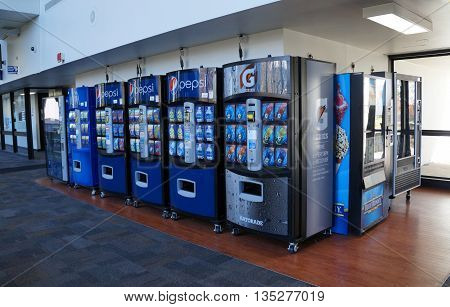 JOLIET, ILLINOIS / UNITED STATES - OCTOBER 25, 2015: Vending machines offer soft drinks and ice cream in the hallway at Joliet Junior College.