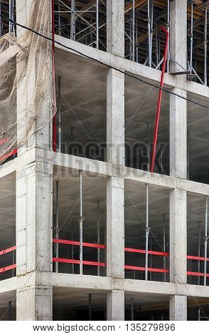 concrete building under construction with monolithic reinforced concrete frame in Moscow Russia