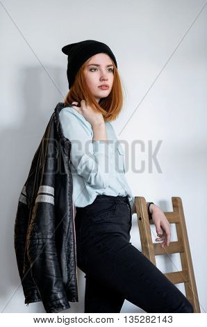 Red-haired Girl Standing Near A Chair