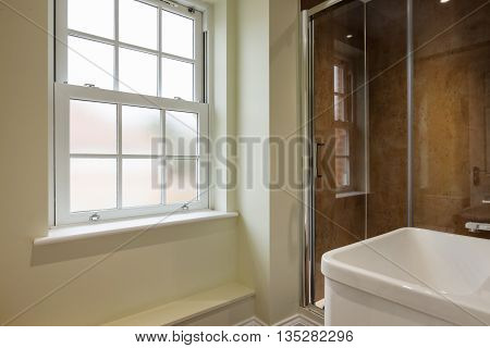 Double shower with sliding glazed doors sink and georgian style window with privacy glass