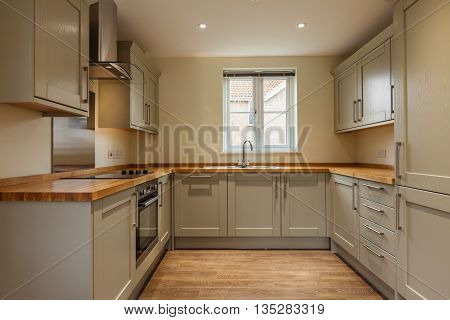 Fitted kitchen with built-in appliances and cupboards