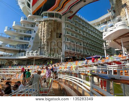 BARSELONA SPAIN - SEPTEMBER 06, 2015: Royal Caribbean Allure of the Seas sailing from Barselona on September 6 2015. The second largest passenger ship constructed behind sister ship Oasis of the Seas. The viewers preparing for the show