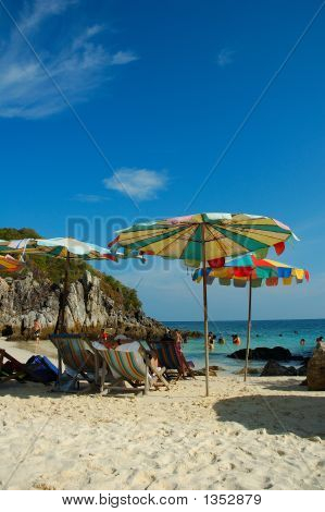 Umbrellas On The Beach Sand