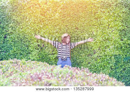 Cheerful happy hipster girl in the garden morning in sunlight,Smiling girl in the garden