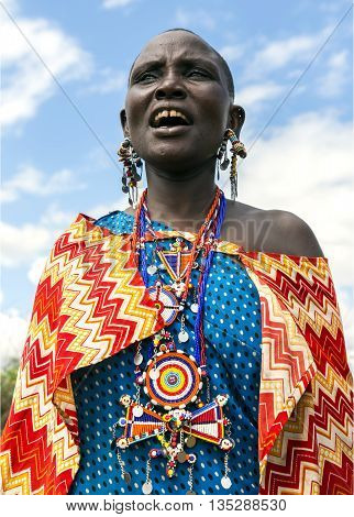 AFRICA, TANZANIA, MAY, 05, 2016 - Maasai tribe woman with traditional piercings and beadwork showing her trinkets in Tarangire National Park, Tanzania.