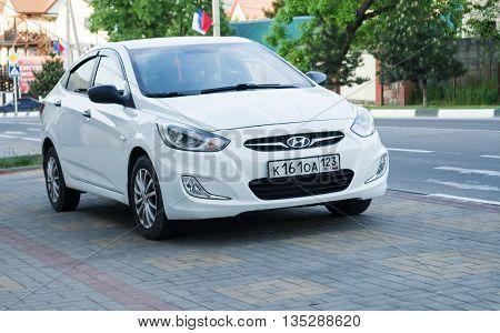 SOCHI RUSSIA - APRIL 29 2016: White Hyundai Solaris parked on the streets Sochi. New korean car.