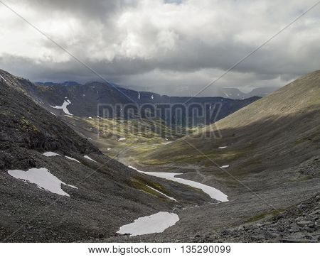 Mountain Valley With Mosses And Rocks Covered With Lichens. Cloudy Sky Before Storm.  Khibiny Mounta