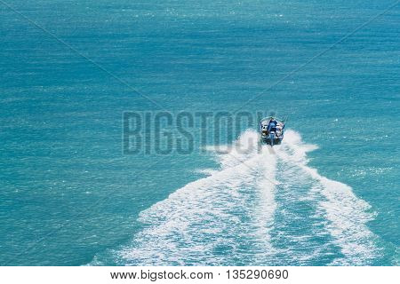 Speed boat moving fast on the turquoise ocean. Motion Blur. Suitable for use as wallpapers.