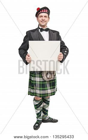 Scottish Man In Traditional National Costume With Empty Banner