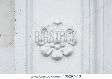 architectural flower fresco on the wall of a building.