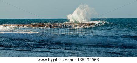 Waves of the Pacific Ocean crashing against the rocks at La Chocolatera near Salinas, Ecuador