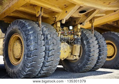 Heavy equipment industrial mining truck suspension closeup