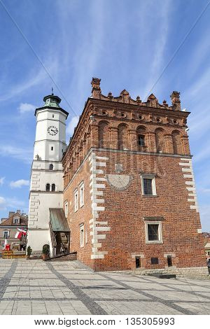 SANDOMIERZ,POLAND- APRIL 29,2016. View on market with Sandomierz Town Hall on sunny day.Sandomierz is known for its Old Town which is a major tourist attraction.